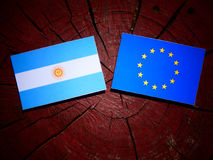 Argentinian flag with EU flag on a tree stump isolated Royalty Free Stock Image