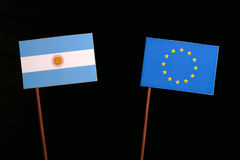 Argentinian flag with European Union EU flag isolated on black Stock Image