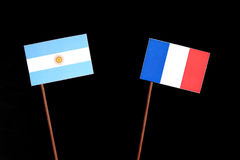 Argentinian flag with French flag isolated on black Royalty Free Stock Photos