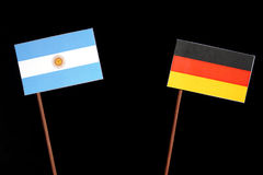 Argentinian flag with German flag isolated on black Royalty Free Stock Photography