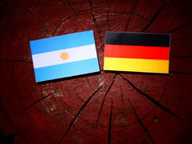 Argentinian flag with German flag on a tree stump  Stock Images