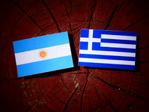 Argentinian flag with Greek flag on a tree stump isolated Royalty Free Stock Photo