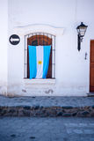 Argentinian Flag Hanging On Patriotic House in South America Stock Photos
