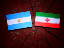 Argentinian flag with Iranian flag on a tree stump isolated Royalty Free Stock Photography