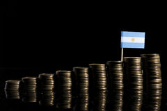 Argentinian flag with lot of coins isolated on black Royalty Free Stock Photos