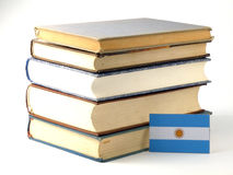 Argentinian flag with pile of books  on white background. Argentinian flag with pile of books  on white Royalty Free Stock Photo