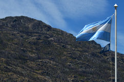 Argentinian Flag rised in Lago Puelo. Argentinian flag, moving with the wind, rised, with mountain behind in Lago Puelo Stock Photos