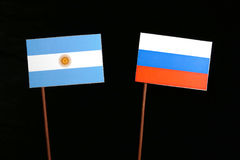Argentinian flag with Russian flag isolated on black Royalty Free Stock Photo