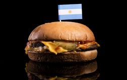 Argentinian flag on top of hamburger isolated on black Stock Image