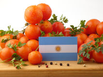Argentinian flag on a wooden panel with tomatoes isolated on a w. Hite background Stock Photo