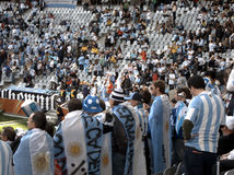 Argentinian football fans. Crowd of football spectators at 2010 South African World cup match with Argentinian supports in foreground Royalty Free Stock Photos