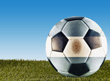 Argentinian football. A football over grass decorated with Argentinian flag Royalty Free Stock Photos