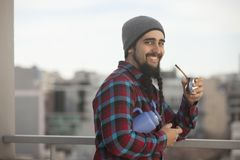 Argentinian man drinking mate ourdoors in Buenos Aires city Royalty Free Stock Images