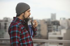 Argentinian man drinking mate ourdoors in Buenos Aires city Stock Photos