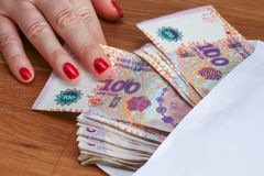 Argentinian money / pesos in the mailer Royalty Free Stock Photos