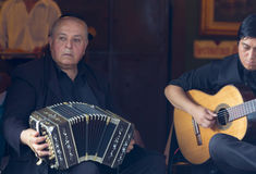 Argentinian musicians playing music in La Bocca in Buenos Aires,. Argentinian musicians playing accordion and guitar in La Bocca in Buenos Aires. Argentina 2014 Stock Image