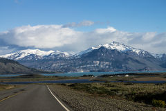 Argentinian Patagonia. A road leading to Argentino lake and the mountains with snowy peaks in the argentinian patagonia, El Calafate Royalty Free Stock Images