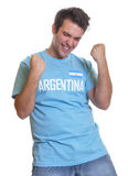 Argentinian soccer fan freaking out. Crazy football fan from Argentina in a blue jersey on a isolated white background Royalty Free Stock Photo