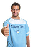 Argentinian soccer fan showing thumb up Royalty Free Stock Photo