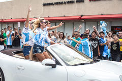 Argentinian soccer fans celebrating - Stock Image. MIAMI BEACH, USA - June 21, 2014: Argentinian fans celebrating the victory on the World Cup Group F game Royalty Free Stock Image