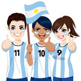 Argentinian Soccer Fans. Young Argentinian soccer fans cheering their Argentina national football team Stock Photography