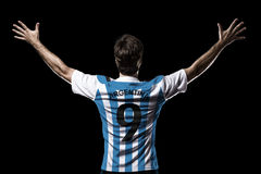 Argentinian soccer player. Celebrating on the black background Royalty Free Stock Image