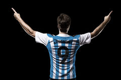 Argentinian soccer player. Celebrating on the black background Stock Images