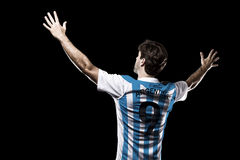 Argentinian soccer player. Celebrating on the black background Stock Image