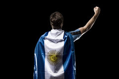 Argentinian soccer player. Celebrating on the black background Royalty Free Stock Photo