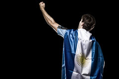 Argentinian soccer player. Celebrating on the black background Royalty Free Stock Photos