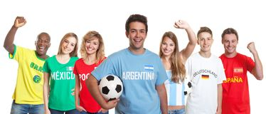 Argentinian soccer supporter with ball and fans from other count stock photos