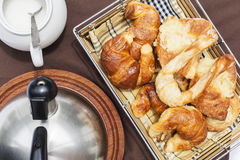 Argentinian traditional breakfast. A breakfast background with a sugar, teapot and croissants tray Stock Images