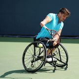 Argentinian wheelchair tennis player Gustavo Fernandez in action during US Open 2017 Wheelchair Men`s Singles semifinal. NEW YORK - SEPTEMBER 9, 2017 Royalty Free Stock Image