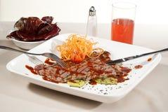 Argentinien-Schnitt des Fleisches gebadet in der traditionellen Soße diente mit VE Stockbilder
