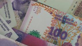 Argentinisches Peso-Geld und finanziell, Steuern, Schuld, Ausgabe, Kredit stock video