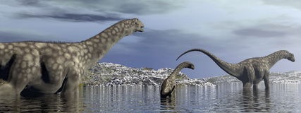Argentinosaurus dinosaurów rodzina - 3D odpłacają się Obrazy Stock