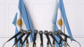 Argentinsk officiell presskonferens Flaggor av Argentina och mikrofoner begreppsmässigt framförande 3d stock illustrationer