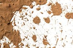 Argilla di struttura che si muove nel fondo bianco. Immagini Stock Libere da Diritti