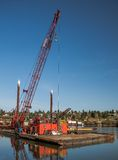 Сargo crane on a barge Stock Image
