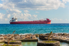 Argo freight ship in the caribbean sea. Freight Transportation. Royalty Free Stock Image