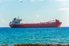 Argo freight ship in the caribbean sea. Freight Transportation. Stock Photos