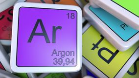 Argon block on the pile of periodic table of the chemical elements blocks. Chemistry related 3D rendering. Argon tag on the pile of periodic table of the Stock Photos