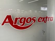 Argos extra store. Argos Ltd, trading as Argos, is a British catalogue retailer operating in the United Kingdom and Ireland, and a subsidiary of Sainsbury`s. The stock photo