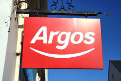 Argos logo advertising sign. Carmarthen, Wales, UK – January 2, 2017:  Argos logo advertising sign outside its retail supermarket stores in the city centre Stock Images