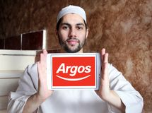 Argos retailer logo. Logo of Argos retailer on samsung tablet holded by arab muslim man. Argos, is a British catalogue retailer operating in the United Kingdom Royalty Free Stock Images