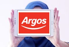 Argos retailer logo. Logo of Argos retailer on samsung tablet holded by arab muslim woman. Argos, is a British catalogue retailer operating in the United Kingdom Stock Photography