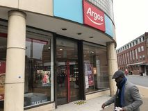 Argos store. Argos Ltd, trading as Argos, is a British catalogue retailer operating in the United Kingdom and Ireland, and a subsidiary of Sainsbury`s. The royalty free stock photography