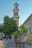 ARGOSTOLI, KEFALONIA, GRIEKENLAND - MEI 25 2015: Zonsondergangmening van Klokketoren van kerk in de stad van Argostoli, Kefalonia Stock Foto's