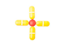 Argt eller plus tecknet som göras med preventivpillerar Royaltyfria Foton
