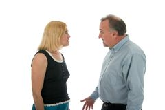 Arguing. Man and woman in a heated argument Royalty Free Stock Photos